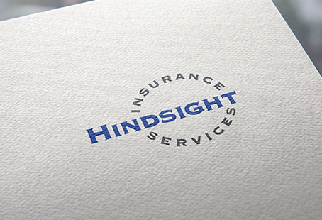 Hindsight Insurance Services logo printed on a paper